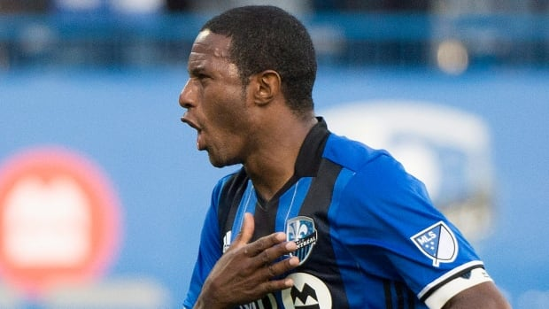 Montreal Impact's Patrice Bernier celebrates after scoring in his final match on Sunday afternoon.