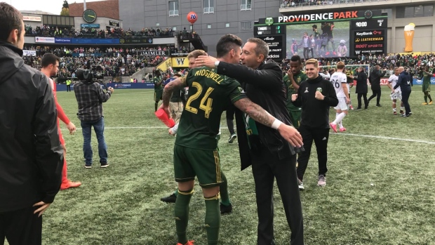 Portland Timbers defender Liam Ridgewell, left, scored the game-tying goal off a rebound from a shot by Darlington Nagbe against the Vancouver Whitecaps on Sunday.
