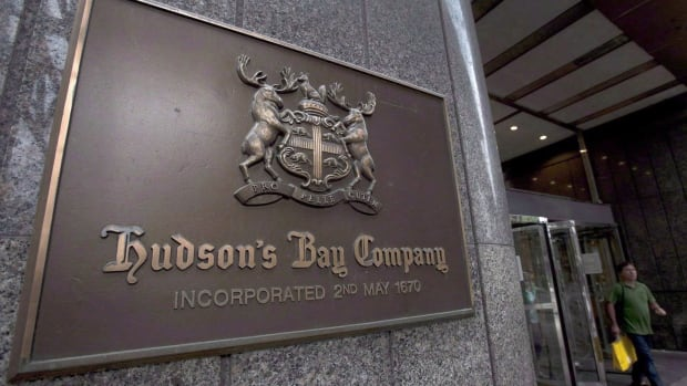 """A Hudson's Bay Co. store sign is shown at its Toronto flagship store on July 29, 2013. Hudson's Bay Co. is hopeful that cost-cutting and investments will bear fruit in the busy fall and holiday season after it lost $201 million in a """"very disappointing"""" second quarter."""