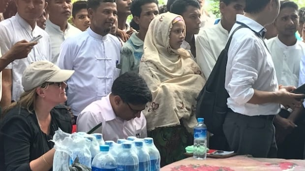 Canadian Ambassador Karen MacArthur, left, meets with Rohingya refugees in Myanmar's Rakhine state on Oct. 2.