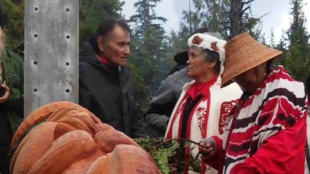 A totem marking victory in the battle against an proposed LNG development on northwest B.C.'s Lelu Island is prepared for a raising ceremony.