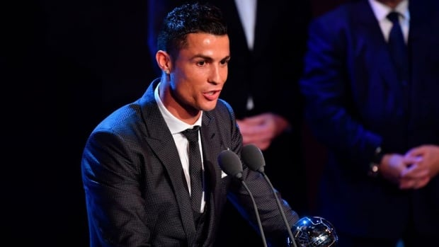 Real Madrid and Portugal forward Cristiano Ronaldo accepts his FIFA player-of-the-year award at a ceremony on Monday.