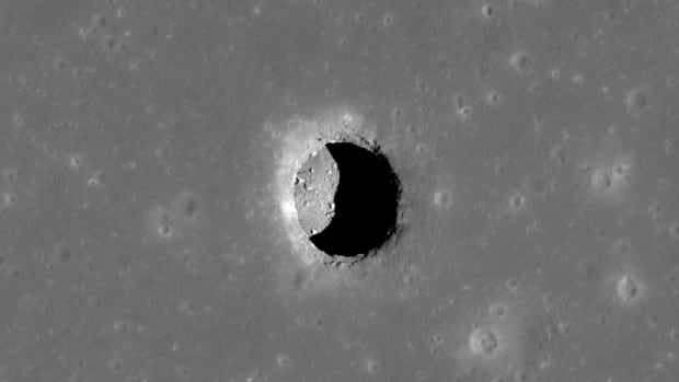 No place like home? A pit crater at Mare Tranquillitatis (the Sea of Tranquility) revealing boulders on an otherwise smooth floor. It's believed that some of the 200-plus pits could actually lead to lava tubes that could house future astronauts.