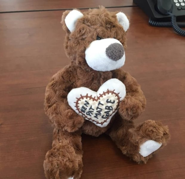 Teddy bear with hunters' names