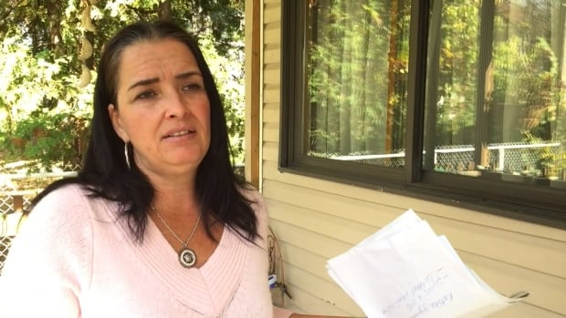 Anic Sauvé says she's exasperated by the slow government response in processing her flood damage claim.