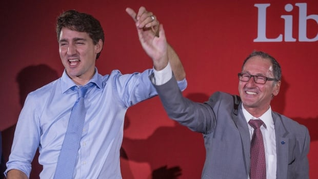Richard Hébert, Liberal candidate for the byelection in the Lac-Saint-Jean riding, right, cheers with Prime Minister Justin Trudeau during a Liberal party rally in Dolbeau-Mistassini, last week. Hébert is projected to win the riding in tonight's byelection.