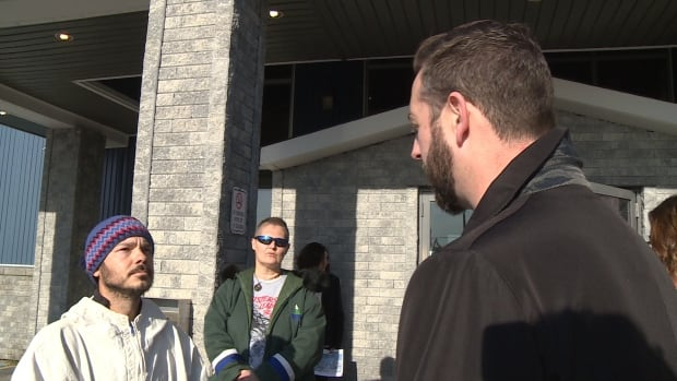 Billy Gauthier confronts Justice and Public Safety Minister Andrew Parsons outside the Labrador Justice Summit Monday.