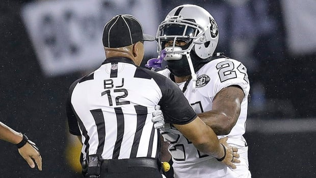Raiders running back Marshawn Lynch, pictured here making contact with back judge Greg Steed (12) during the first half of last Thursday's game against visiting Kansas City in Oakland, had his appeal of a one-game suspension denied on Tuesday.
