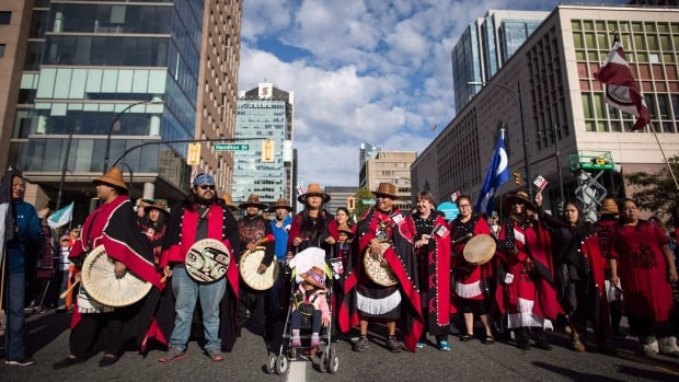 First Nations people wait for the Walk for Reconciliation to begin in Vancouver, B.C., on Sunday September 24, 2017. A high fertility rate and a growing sense of self are fuelling an explosion in the ranks of Indigenous Peoples.