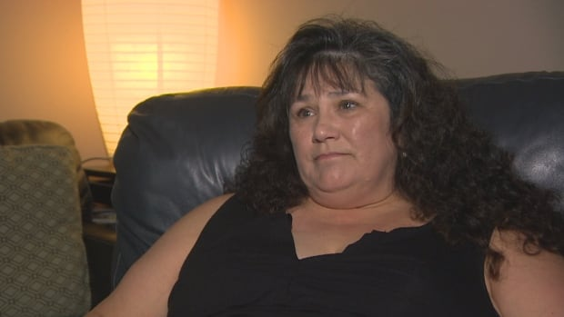 RCMP employee Bonnie Muth fears dust that covered a room where her files were stored was contaminated with lead from the nearby firing range and may have affected her health.