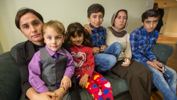 CBC News spoke to members of a family who came to Canada this past year as part of a federal program to resettle 1,200 Yazidis and other survivors of ISIS atrocities by the end of 2017. Left to right: Melkeya and her 3-year-old son Hawar; Shahrestan, 8, Haval, 10, and their mother Basema; and Basema's 13-year-old son Hazal.