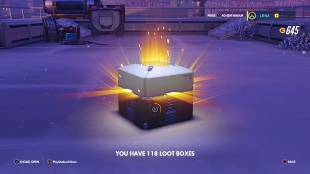 Pictured is a loot box containing an unknown assortment of in-game items found in the online multiplayer game Overwatch.