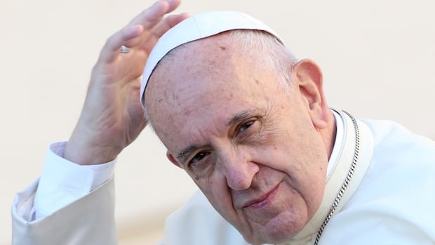 Pope Francis arrives during his general audience in St. Peter's Square at the Vatican on Wednesday.