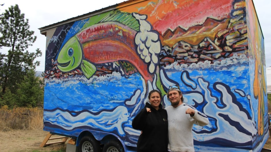 Mayuk Manuel and her partner Isha Jules standing next to a tiny house they helped build.