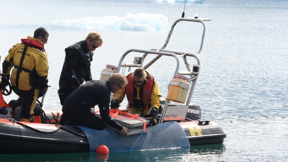 Researchers deploy concrete slabs to support the heated settlement panels on the seafloor at Rothera Research Station, Antarctica.