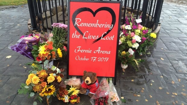 A memorial is seen outside of City Hall in Fernie, B.C. after an ammonia leak at the local ice rink killed Fernie residents Wayne Hornquist, 59, and Lloyd Smith, 52, and 46-year-old Jason Podloski of Turner Valley, Alta.