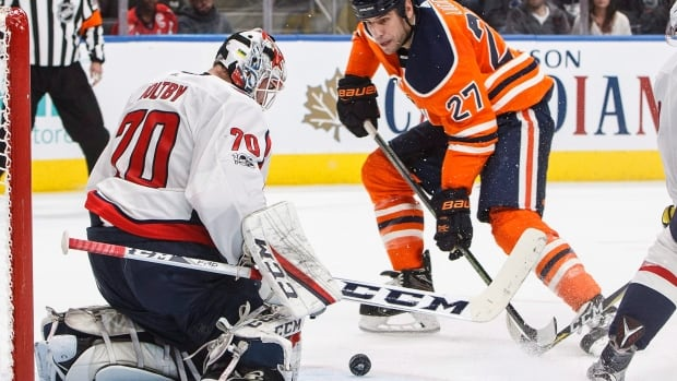 Washington Capitals goalie Braden Holtby (70) makes the save on Edmonton Oilers' forward Milan Lucic (27) during the second period Saturday at Rogers Place.