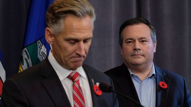United Conservative Party leader Jason Kenney, right, looks on as Dave Rodney announces his resignation as the MLA for Calgary-Lougheed effective Nov. 1. Rodney's resignation allows Kenney to run for his seat in the legislature.