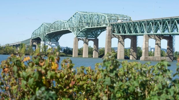 The Champlain Bridge crossing the St-Lawrence river is seen from the south shore of Montreal in Brossard, Que., on October 5, 2011. The federal Liberals plan to shift just over $2 billion in planned infrastructure spending to future years, reflecting slower-than-anticipated spending on the file, The Canadian Press has learned.