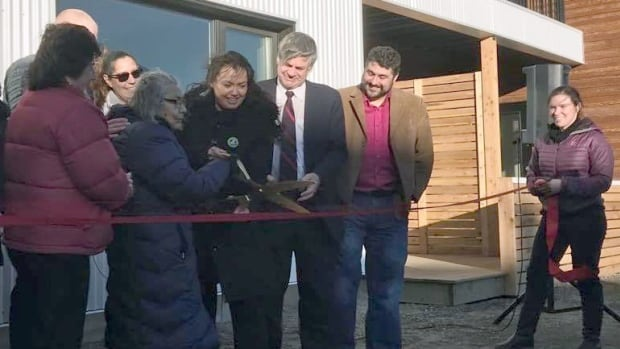 Ta'an Kwäch'än First Nation elder Frances Woolsey and Chief Kristina Kane cut the ribbon for the River Bend housing development.