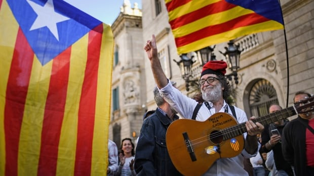 Independence supporters gathered outside the Palau Catalan Regional Government Building on Monday following last week's decision by the Catalan parliament to vote to split from Spain. The Spanish government responded by imposing direct rule and dissolving the Catalan parliament.