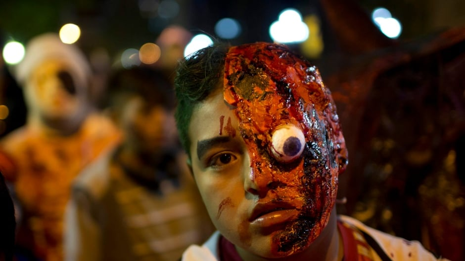 A youth attends the Zombie Walk in La Paz, Bolivia, late Saturday, Oct. 28, 2017.