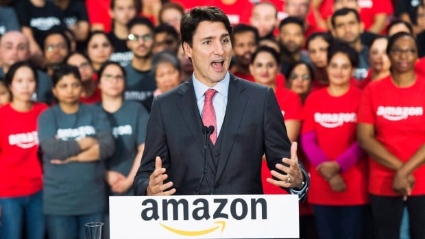 Prime Minister Justin Trudeau visits a new Amazon fulfilment centre while he makes an announcement in Brampton, Ont., on Oct. 20, 2016. Amazon has said it's 'seeking to influence policy direction related to cloud-based services.'