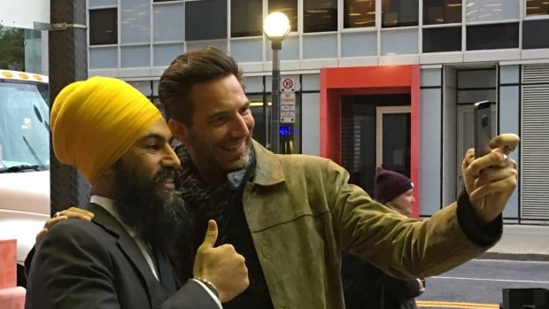 New federal NDP leader Jagmeet Singh poses for a photo in downtown Toronto. Singh says he would consider running in a Greater Toronto Area seat if one became available.