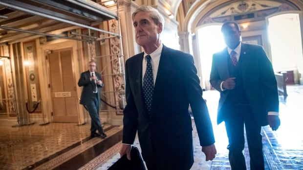 Special Counsel Robert Mueller departs after a closed-door meeting with members of the Senate Judiciary Committee on June 21. With the announcement of the first charges resulting from his investigation, it remains to be seen if Muller's probe is in the homestretch or at the beginning of a very long process.