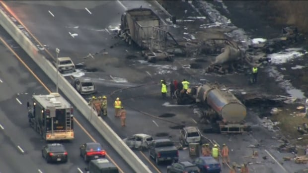 An aerial view of the crash site on Highway 400 on Wednesday. Witnesses describe seeing multiple explosions, while a police officer described what had happened as 'absolute devastation.'