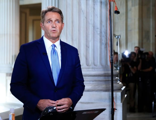 Republican Sen. Jeff Flake, who promised to speak freely after announcing he won't run in next year's midterms, quickly corrected the president on his interpretation of a past legislative effort regarding visas. (Manuel Balce Ceneta/Associated Press)