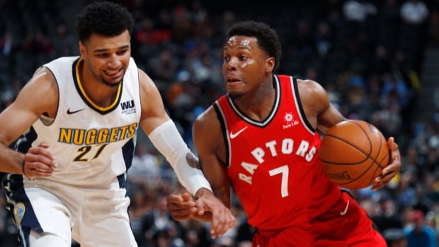 Toronto Raptors guard Kyle Lowry, right, drives past Denver Nuggets guard Jamal Murray in the first half of Denver's win on Monday.