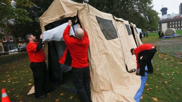 Provincial funding helped pitch a new, winterized tent on Thursday afternoon to help the Moss Park overdose prevention site stay open in cold weather.