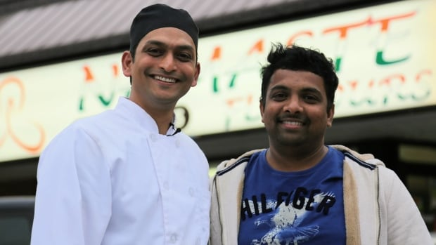Chef Navneet Jaiswal (left) and owner Krishna Kody in front of their restaurant, Namaste Flavours.