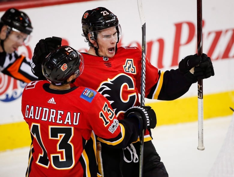 Mike Smith holds fort as Flames burn Penguins in OT  613edac50