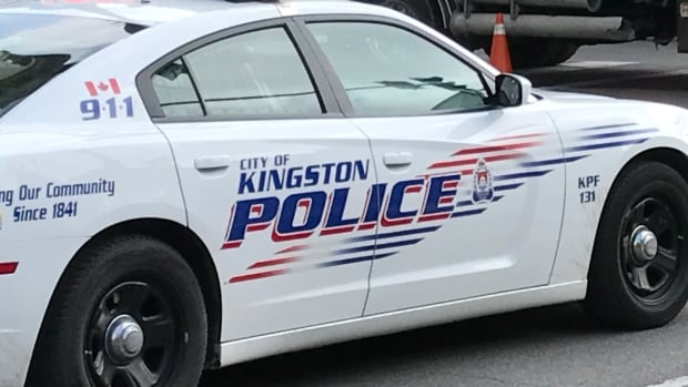 Kingston police have charged a 25-year-old man with two counts of assault with a weapon, alleging he shot his girlfriend and her children with Q-Tips fired from a BB gun.