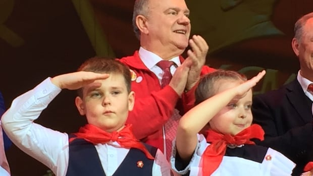 Communist Party leader Gennady Zyuganov, rear, leads an investiture ceremony for youth members.