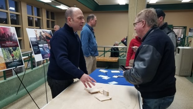 City staff walk the public through a model of the site plan for the new Kingsway event centre at a public consultation on Friday.