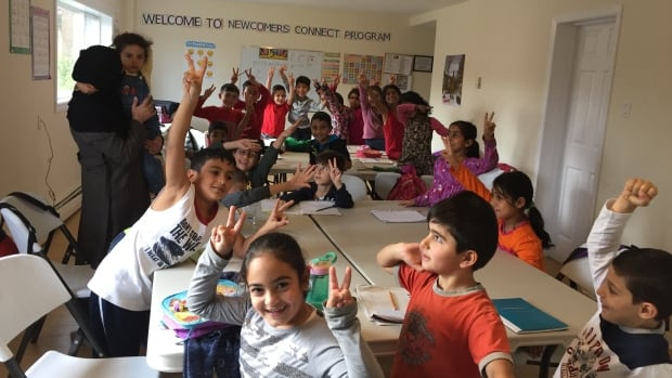 Children in grades 1-2 at the Syrian Arabic school.