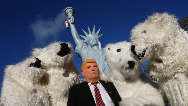 Protesters dressed as U.S. President Donald Trump and polar bears demonstrate on Nov. 4, two days before the start of the COP 23 UN Climate Change Conference in Bonn, the first major conference on climate change since Trump said that the U.S. will pull out of the Paris accord unless his administration can secure a better deal.
