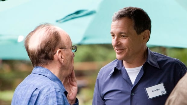 Rupert Murdoch, left, is shown talking with Disney head Robert Iger at a media conference several years ago. The two companies are reportedly in talks about selling much of Murdoch's Twenty-First Century Fox unit to Disney.