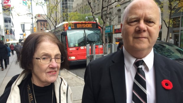 Terrance Green, right, complained successfully to the Canadian Transportation Agency in 2006 about OC Transpo drivers failing to call out stops. More than a decade later, he and his wife Lorraine, who is also visually impaired, say an automated announcement system frequently malfunctions.