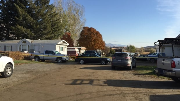 Police investigate a trailer connected with armed standoff in Kamloops in October.