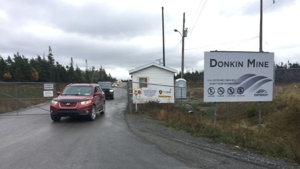 Laid-off miners leave Donkin Mine on Tuesday. About 49 of the 130 people working at the coal-mining operation have lost their jobs.