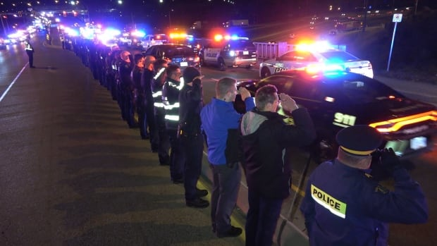 Officers line the highway to pay their respects to Const. John Davidson, killed in the line of duty in Abbotsford on Nov. 6.