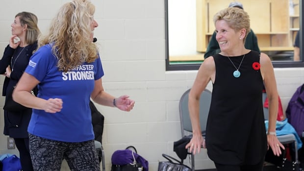 Premier Kathleen Wynne, right, takes in an exercise class at the Sackville Hill Seniors Recreation Centre with fitness instructor Sharon Beaudet Tuesday. Wynne announced the Aging with Confidence plan for seniors, which includes 5,000 long term care beds over four years and an average of four hours per day of nursing or personal care support.