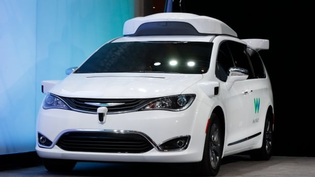 In this Sunday, Jan. 8, 2017, file photo, a Chrysler Pacifica hybrid outfitted with Waymo's suite of sensors and radar is shown at the North American International Auto Show in Detroit. Waymo is testing vehicles on public roads with only an employee in the back seat.