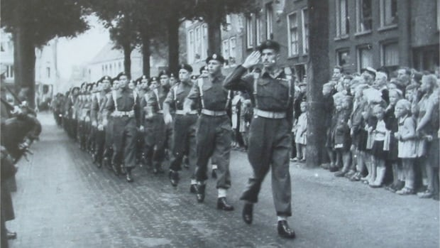 This photo of West Vancouver's Harry Macdonald leading his troop in a parade somewhere in Holland at the end of WWII was a big mystery to daughter Marion Haythorne.