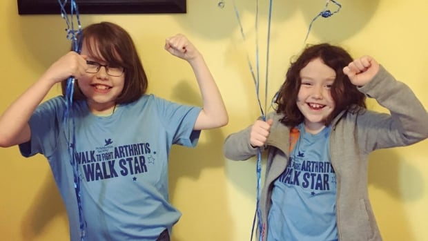 Mya Healey, left, was diagnosed with juvenile arthritis when she was two. She's now raising money with her sister, Lily Healer, to give back to the Arthritis Society.
