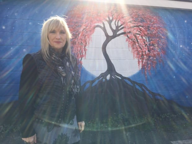 Artist Judy Depassio and her mural The Tree of Life